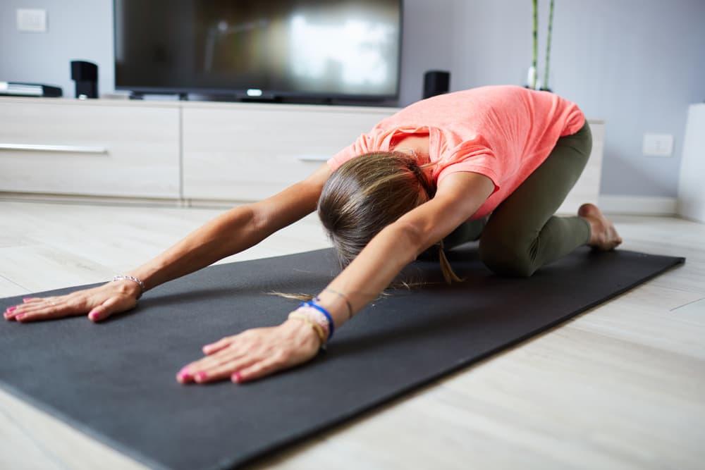 Child's Pose Yoga TV Living Room